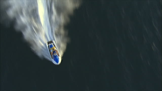 aerial ws ts jetboat rider, eilat, arava, israel - acquascooter video stock e b–roll