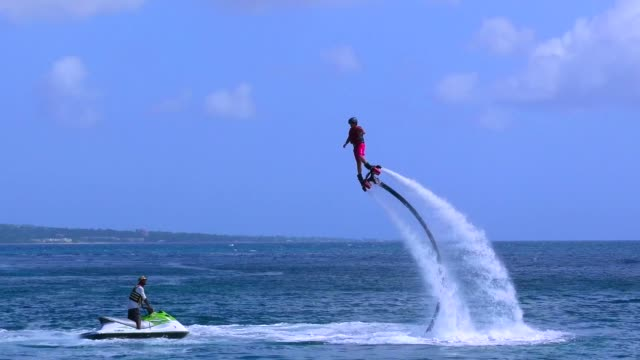 jetpack flight in the sea - hovering stock videos & royalty-free footage
