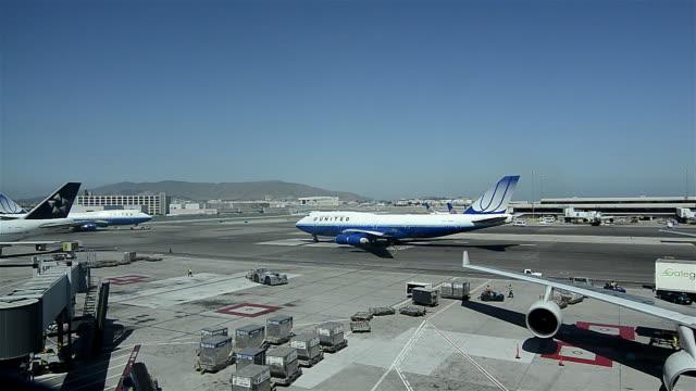 wa ha jets moving on the tarmack / san francisco, california, usa - asphalt stock videos & royalty-free footage