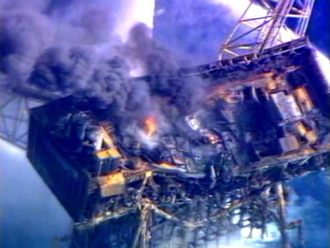 jets of water are fired at the burning wreckage of the piper alpha oil rig. - alpha cell stock videos & royalty-free footage