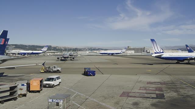t/l ws jets on san francisco international airport runway, san francisco, california, usa - san francisco international airport stock videos & royalty-free footage