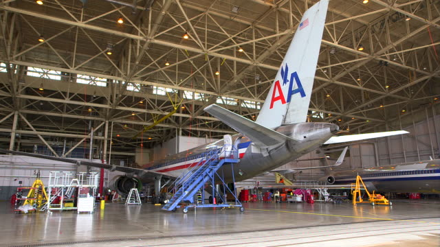 PAN AA jets (Boeing 757 & MD-80) parked in hanger for service/DFW International Airport, Dallas-Fort Worth, Texas, USA