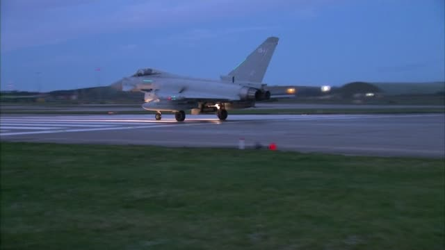 raf jets take off from lossiemouth night typhoon jet on runway and along / a400 transport plane along tarmac - typhoon stock videos and b-roll footage