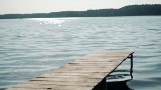 jetty and glitter water on lake - jetty stock videos & royalty-free footage