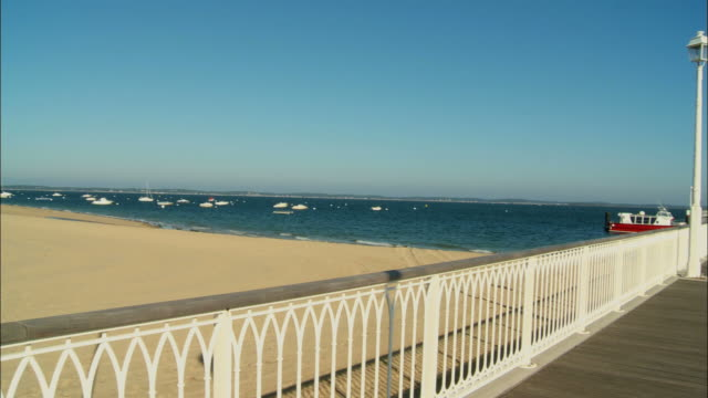 ws, pan, jetty in arcachon bay, aquitaine, france - arcachon stock videos & royalty-free footage
