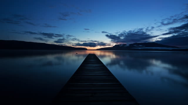 t/l, ws, jetty on lake tarawera at sunset, rotorua, north island, new zealand - vanishing point stock videos & royalty-free footage