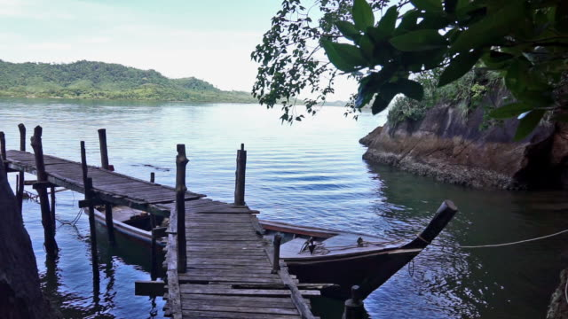 jetty on secluded tropical island, ko pee, krabi, thailand - ko lanta stock videos & royalty-free footage