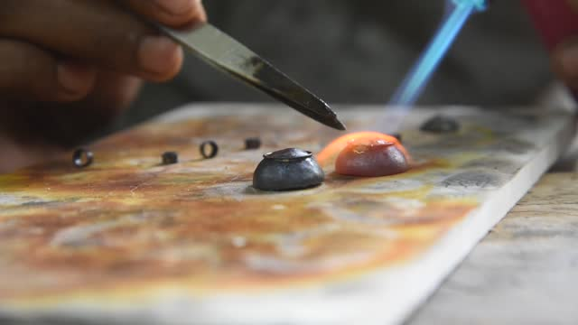 vídeos de stock, filmes e b-roll de jeweler busy making assamese traditional jewelry ahead of rongali bihu festival on march 26, 2021 in nagaon, india. female bihu dancers wear assamese... - joia