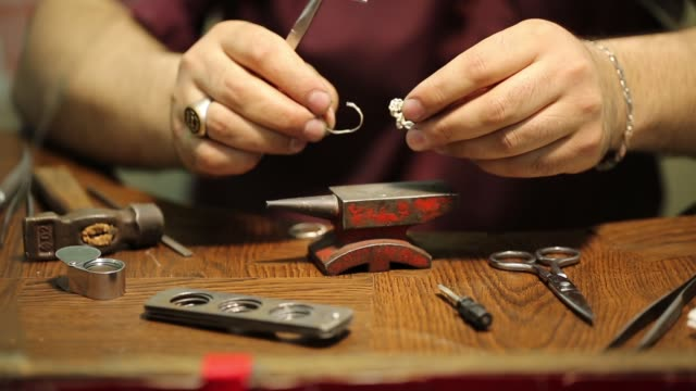 jeweler. jewelry repair shop. - craft stock videos and b-roll footage