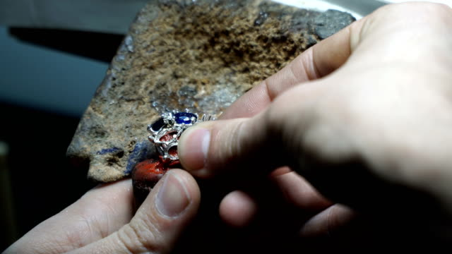 jeweler works with diamonds - one mid adult man only stock videos & royalty-free footage