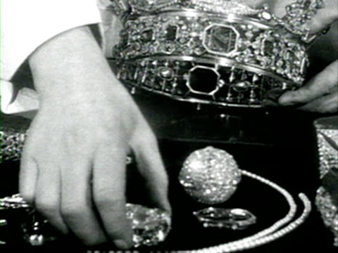 a jeweller checks and cleans the imperial state crown in preparation for the coronation of elizabeth ii 01 june 1953 - coronation stock videos and b-roll footage