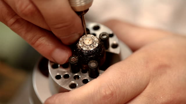 jeweller hand polishing golden ring - expense stock videos and b-roll footage