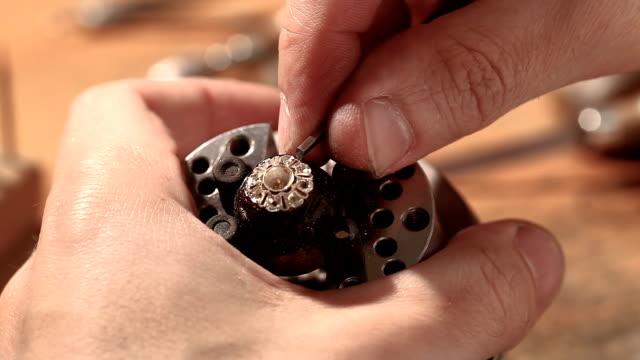 jeweller hand polishing golden ring - ring jewelry stock videos and b-roll footage
