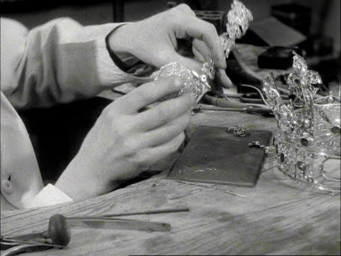 vídeos y material grabado en eventos de stock de a jeweller starts to reattach sections of the st edwards crown in preparation for the coronation of elizabeth the second 1953 - joyas