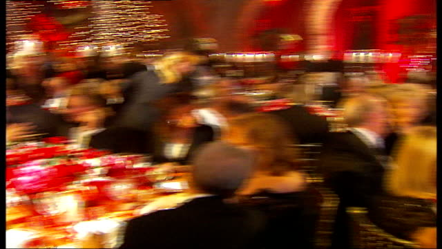 jewellers cartier throw party for wealthy customers int guests seated at tables around fossilised dinosaur skeleton - cartier video stock e b–roll