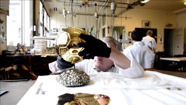 Jewellers in Paris are hard at work putting the finishing touches on the Ballon dOr which will be presented to either Lionel Messi or Cristiano...
