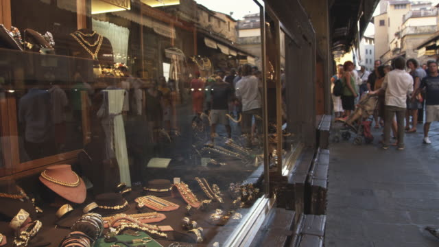 ms jewelry display window with people walking by / florence, italy - facade stock videos & royalty-free footage