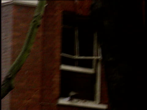 TX ENGLAND Kensington CMS Blown out window in building beside embassy PULL OUT to bombed building NAO