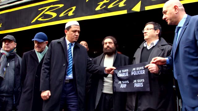 Jewish community from CRIF pay tribute to victims of both Charlie Hebdo and November 2015 terrorist attacks in Paris France Slow motion of them...