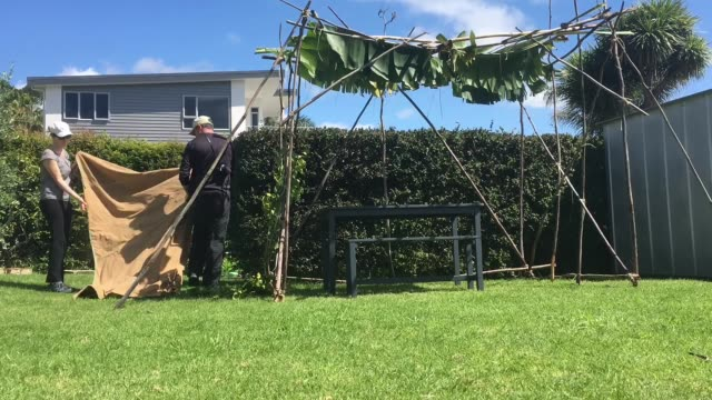 Jewish Couple Building a Sukkah on Sukkoth Feast of Tabernacles Jewish holiday