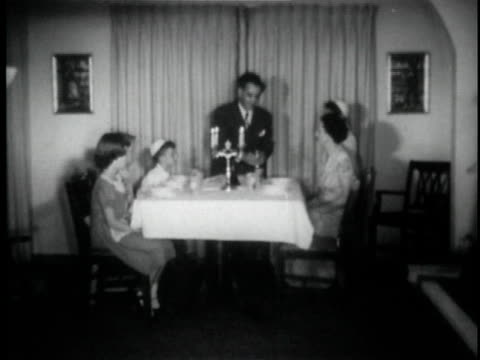 b/w ws jewish family praying before meal at dining table / usa - judaism stock videos and b-roll footage