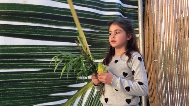 Jewish Girl Blessing on the fFour Species on the Jewish Festival of Sukkot