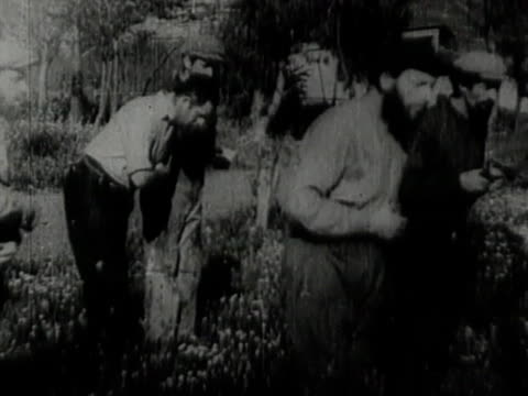 jewish immigrants in palestine bowing and reading prayer in garden - judaism stock videos & royalty-free footage