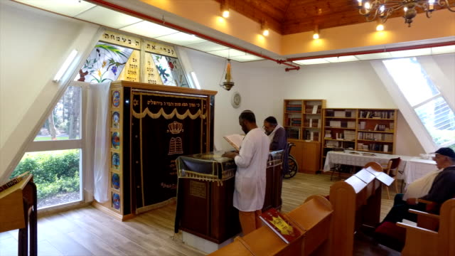 jewish man of ethiopian descent leads the mincha prayer service in northern israel - judaism stock videos & royalty-free footage