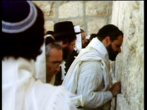 Jewish men and women pray at the Wailing Wall.