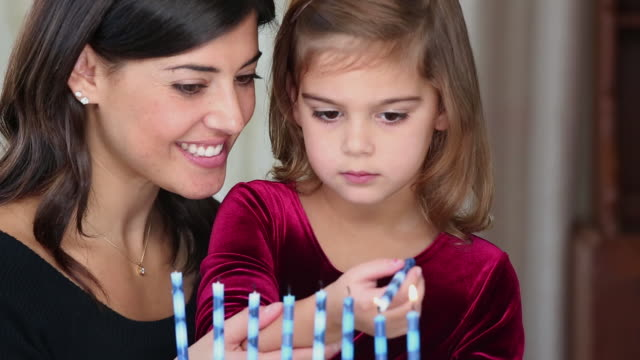 ms jewish mother and daughter lighting hannukah candles / richmond, virginia, usa - judaism stock videos and b-roll footage