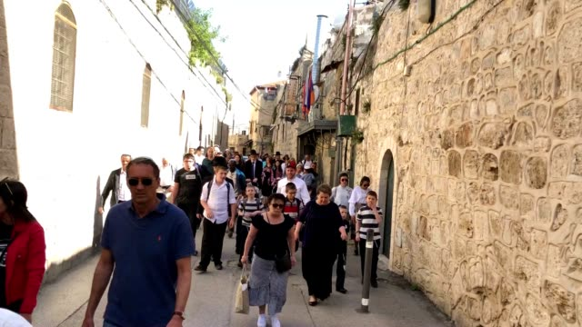 jewish pedestrians walk in the old city towards the western wall - passover stock videos and b-roll footage