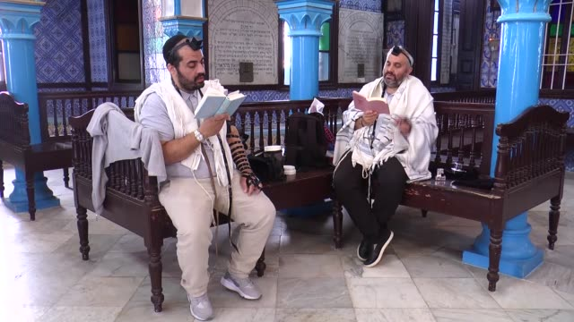 jewish pilgrims perform religious services during the annual pilgrimage to ghriba synagogue the oldest synagogue in africa on the tunisian island of... - religious service stock videos and b-roll footage