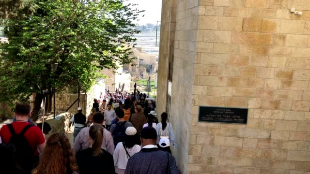 jewish pilgrims walk in the old city towards the western wall during the passover holiday - passover stock videos and b-roll footage