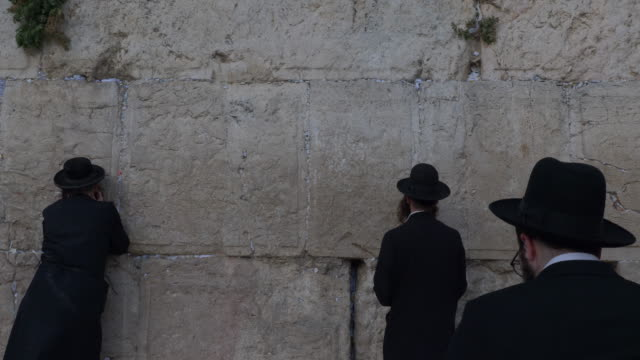 jewish prayers in wailing wall - surrounding wall stock videos & royalty-free footage