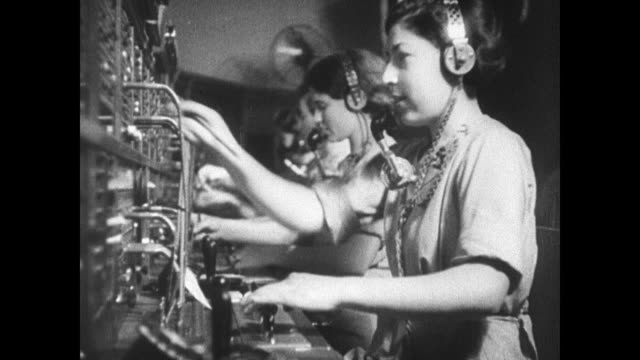 jewish women working hebrew telephone service switchboard boats in harbor fg w/ merchant marines ships bg - 電話交換機点の映像素材/bロール