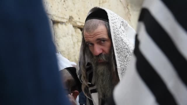 jewish worshippers gathered at the western wall in jerusalem's old city thursday for a special priestly blessing for the holiday of passover - passover stock videos and b-roll footage