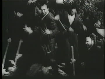 jews in a nazi concentration camp dig a mass grave with shovels. - judaism stock videos & royalty-free footage