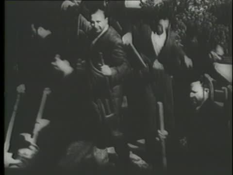 jews in a nazi concentration camp dig a mass grave with shovels. - campo di concentramento video stock e b–roll
