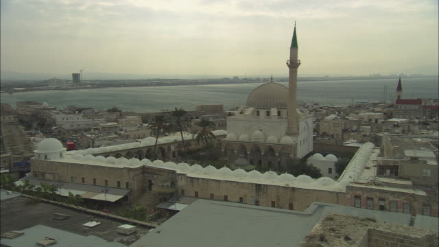 ws ha pan jezzar pasha mosque and crusader's citadel with the mediterranean sea in background / acre, israel - akko stock videos and b-roll footage