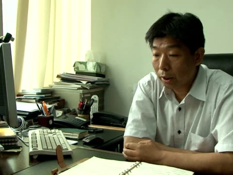 ji yunliang worked as a missile researcher at a large state-owned enterprise and later earned a doctorate in chemistry at a prestigious beijing... - politik und regierung stock-videos und b-roll-filmmaterial