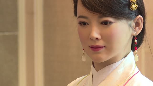 jia jia can hold a simple conversation and make specific facial expressions when asked and her creator believes the eerily lifelike robot heralds a... - robot and human face stock videos & royalty-free footage