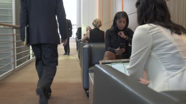 jib shot of a businesswoman using a smartphone - employee engagement stock videos & royalty-free footage