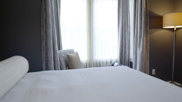 jib shot of a hotel room during daytime - jib shot stock videos & royalty-free footage
