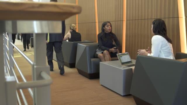 jib shot of two businesswomen talking - employee engagement stock videos & royalty-free footage