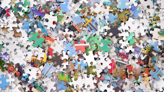 4k jigsaw puzzle pieces - turning on a turntable (top down) - puzzle video stock e b–roll