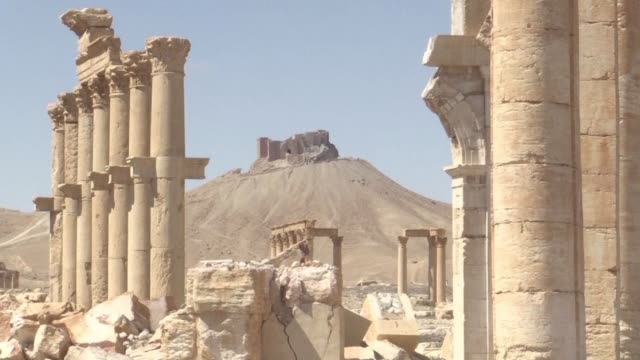 jihadists of the islamic state group have demolished two more treasured monuments in the ancient syrian city of palmyra a month after recapturing it... - antiquities stock videos & royalty-free footage