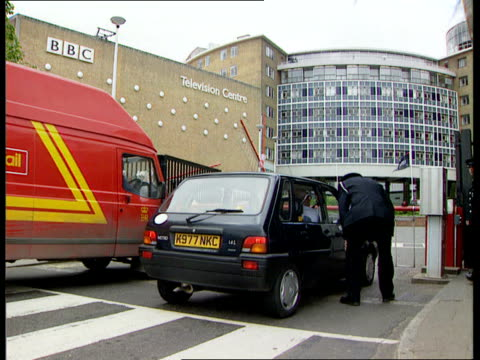 bbc's tony hall receives death threat itn england london bbc television centre ext barriers lowered at entrance to television centre as car and van... - bbc video stock e b–roll