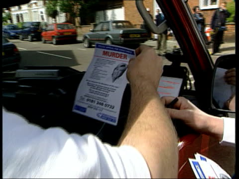 door to door inquiries lib england london fulham policeman questioning van driver van driver holding 'murder' leaflet for information about dando... - jill dando stock videos and b-roll footage