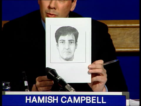 efit picture of suspect released by police england london detective chief inspector hamish campbell holding up computergenerated efit picture of man... - image manipulation stock videos and b-roll footage