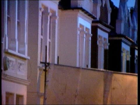 jill dando murder; england: london: fulham: ext at night gv street where television presenter jill dando was murdered zoom in police screen at... - jill dando stock videos & royalty-free footage